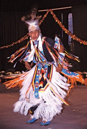 Cherokee boy dancing in full Cherokee Indian costume